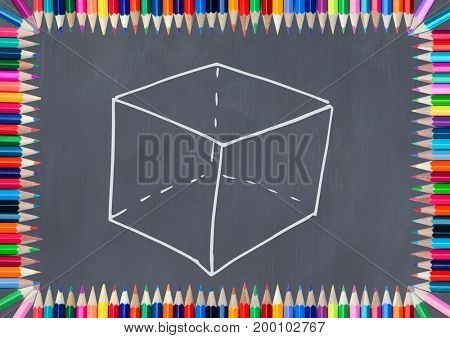 Digital composite of cube on blackboard with coloring pencils