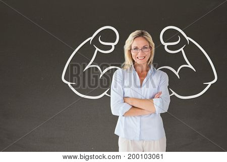 Digital composite of Happy student woman with fists graphic standing against grey blackboard