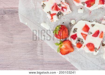 Homemade healthy frozen strawberry yogurt bark. Top view