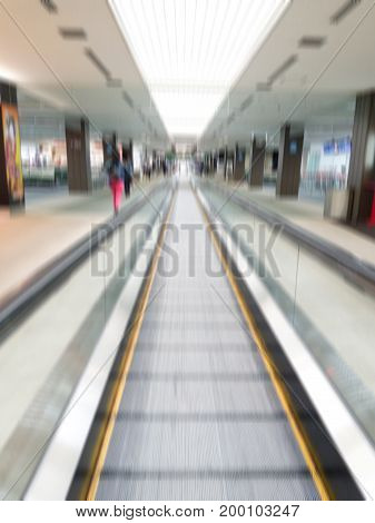 Escalator for Passenger in the Airport Terminal - motion blur
