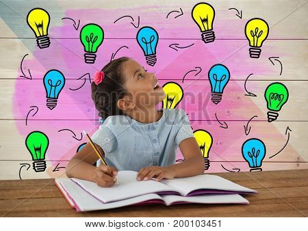 Digital composite of Schoolgirl writing at desk with colorful light bulbs graphics