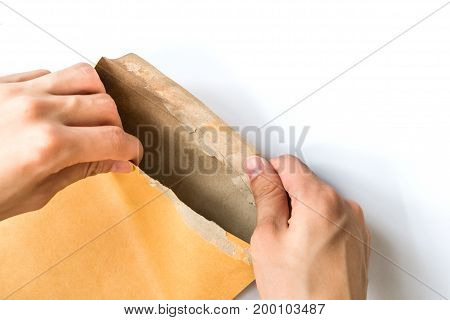 hand opening brown Document Envelop isolated on white background