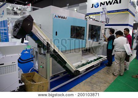 Bangkok Thailand - June 23 2017 :Worker operating bottle cap making machine in factory