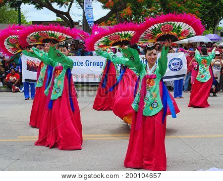 SAIPAN, CNMI--Members of the BJ Dance Group from Korea joins in the street dancing at the Liberation Parade in Saipan with their colorful costumes in July 2015.