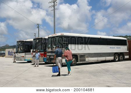 SAIPAN, CNMI--Buses wait for passengers from a cruise ship at the Saipan seaport to take them around the island in April 2016. Saipan is one of the stopovers of cruise ships in the pacific.