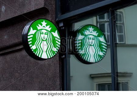 BUDAPEST HUNGARY - AUGUST 11 2017: Starbucks logo in front of a Starbucks coffeehouse in the city center of Budapest capital city of Hungary