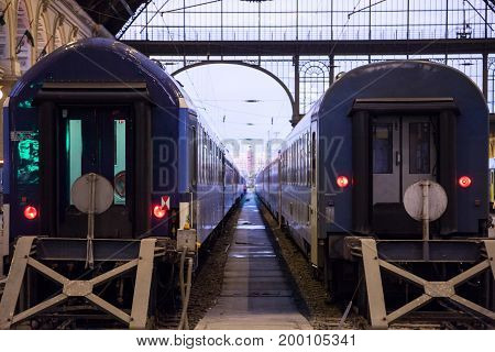 BUDAPEST HUNGARY - AUGUST 12 2017: Trains departing from the interior of Budapest Keleti Palyaudvar train station. This station is the biggest of Hungary both in terms of size and traffic capacity and a domestic and international hub for rail traffic