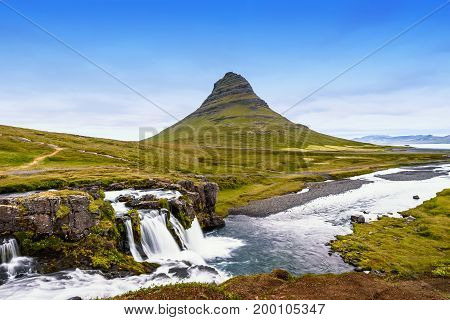 Beautiful Kirkjufell mountain with cloudy Snaefellsnes peninsula Iceland selective focus