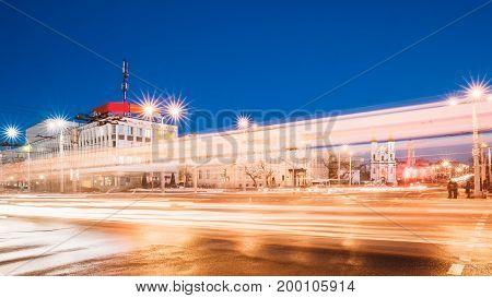 Vitebsk, Belarus. Traffic At Intersection Of Lenina Street, Zamkovaya Street And Frunze Avenue. City Center In Night Illumination At Winter Season.