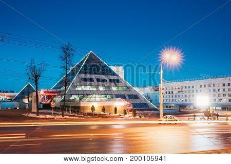 Vitebsk, Belarus. Shops In Pyramid Shape In Lenin Street At Winter Season. View From Gogol Street In Evening Or Night Illumination In Vitebsk, Belarus