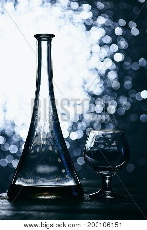 Bottle Of Cognac Or Whiskey And Empty Glass