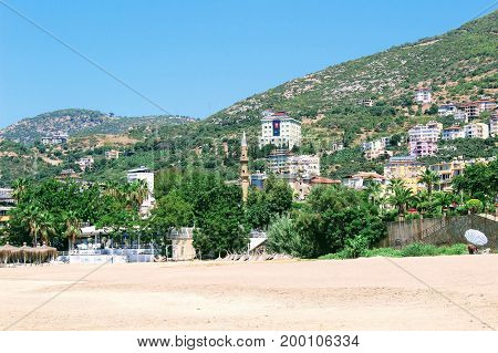 Typical city landscape from the beach of Cleopatra Beach (Alanya, Turkey).