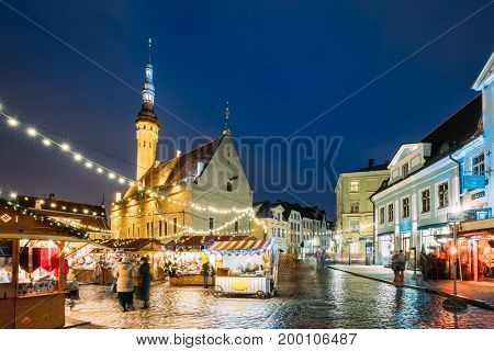 Tallinn, Estonia. Traditional Christmas Market On Town Hall Square. Christmas Tree And Trading Houses With Sale Of Christmas Gifts, Sweets And Mulled Wine. Famous Landmark
