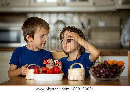 Two Sweet Children, Boy Brothers, Eating Fresh Fruits At Home