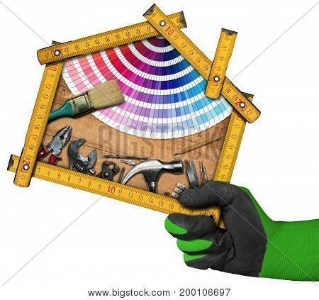 Home improvement concept - Hand with work glove holding a yellow wooden meter ruler in the shape of house with work tools. Isolated on white background