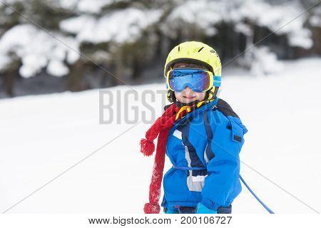 Cute Little Boy, Learning To Ski In Austrian Ski Resort
