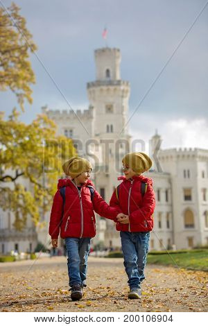 Two Beautiful Children, Boy Brothers, Walking On A Path In Beautiful Renaissance Castle Hluboka