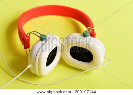 Modern And Stylish Earphones On Yellow Background