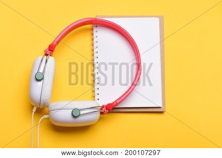 Music Accessories And Note Taking Concept. Modern And Stylish Earphones