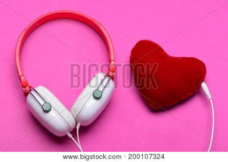 Modern And Stylish Earphones Isolated On Pink Background