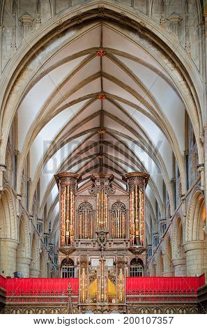 Gloucester United Kingdom - June 8 2013: View of Gloucester Cathedral organ and vaulted ceiling