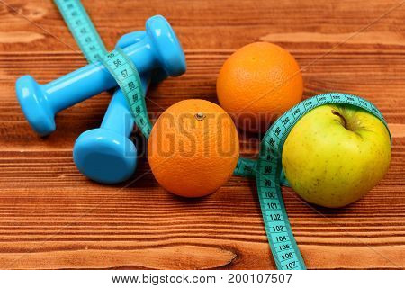 Weightlifting Concept, Dumbbells Weight With Measuring Tape, Fruit