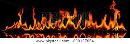 Creative photo of fire flames on black background.