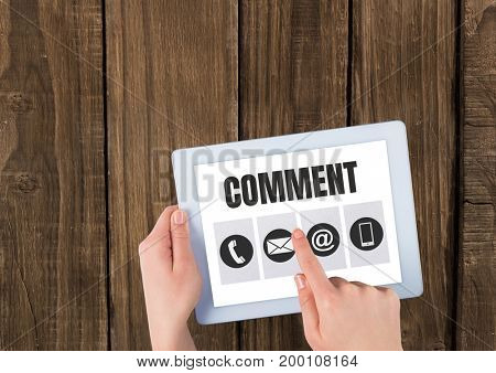 Digital composite of Comment text and graphic on tablet screen with hands