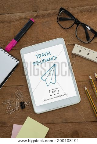 Digital composite of Tablet with travel insurance concept on screen