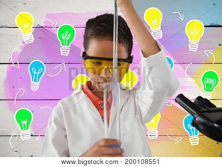 Digital composite of Boy scientist working in lab with colorful light bulb graphics