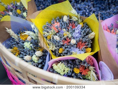 Bouquets of wildflowers in a basket on the market