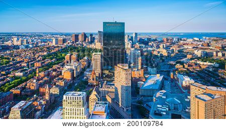 Boston - June 2016, Massachusetts, USA: Boston skyline at the evening. View on downtown and John Hancock Tower from the top of The Prudential Center in Back Bay
