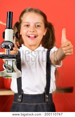 Schoolgirl With Happy Face And Thumbs Up