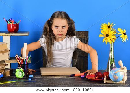 Girl With Angry Face Expression. Kid And School Supplies