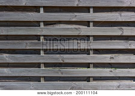 Background fence with horizontally oriented wooden boards.