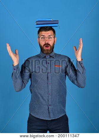 Knowledge And Studying Concept. Man With Beard And Books