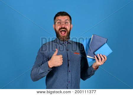 Professor With Very Happy Face. Man With Beard And Books