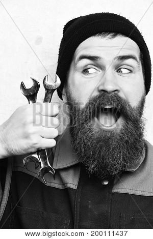 Bearded Brutal Caucasian Mechanic Holding Metallic Wrenches