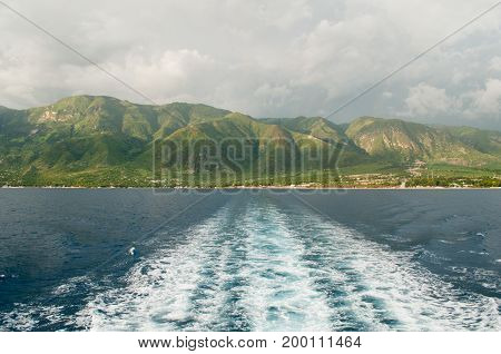 Mountains Of Haiti as seen from the stern of a ocean vessel.