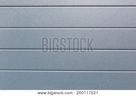 Textured background of metal shiny silver. Modern design