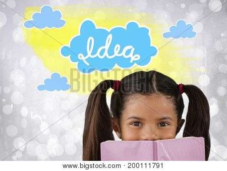 Digital composite of Girl reading with colorful idea graphics clouds