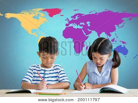 Digital composite of School kids writing at desk in front of colorful world map