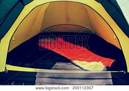 Orange Sleeping Bag In The Tent.