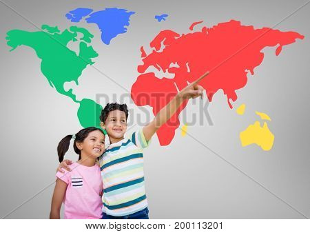 Digital composite of Kids pointing in front of colorful world map