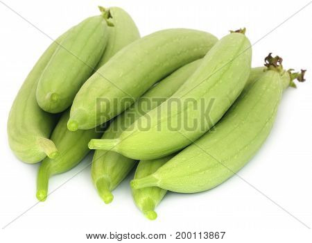 Fresh ridge gourd Luffa aegyptiaca over white background