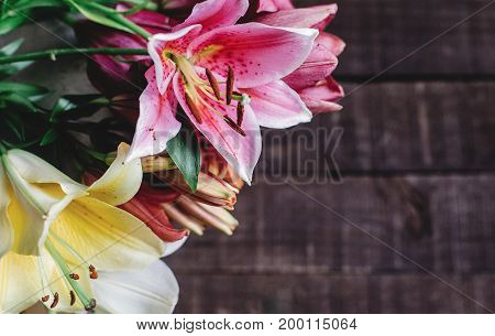 Beautiful Colorful Lily Flowers On Wooden Background. Yellow Pink And White Lilies On Rustic Wood Ba