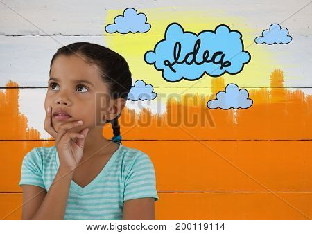 Digital composite of Girl looking up with colorful idea cloud graphics and painted wall