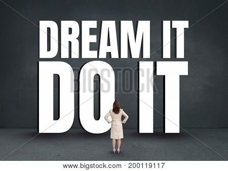 Digital composite of Business woman standing in front of a motivational text