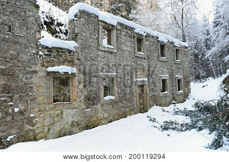 Dolsky mill in the Czech Switzerland with snow and frost