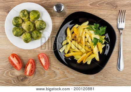 Fried Potatoes In Plate, Brussels Sprouts, Pepper, Tomatoes And Fork